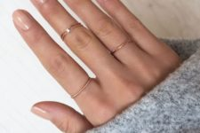 13 several minimalist gold rings, one of them with a rhinestone is a cool way to accessorize your hands