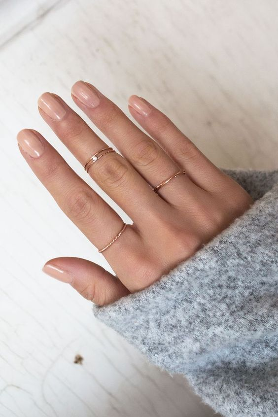 several minimalist gold rings, one of them with a rhinestone is a cool way to accessorize your hands