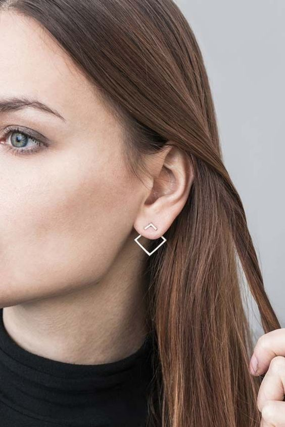 a minimalist geometric earring will make a statement but won't look excessive at the same time