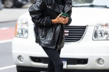 14 black leggings, black boots, a black hoodie and an oversized leather jacket worn by Hailey Bieber