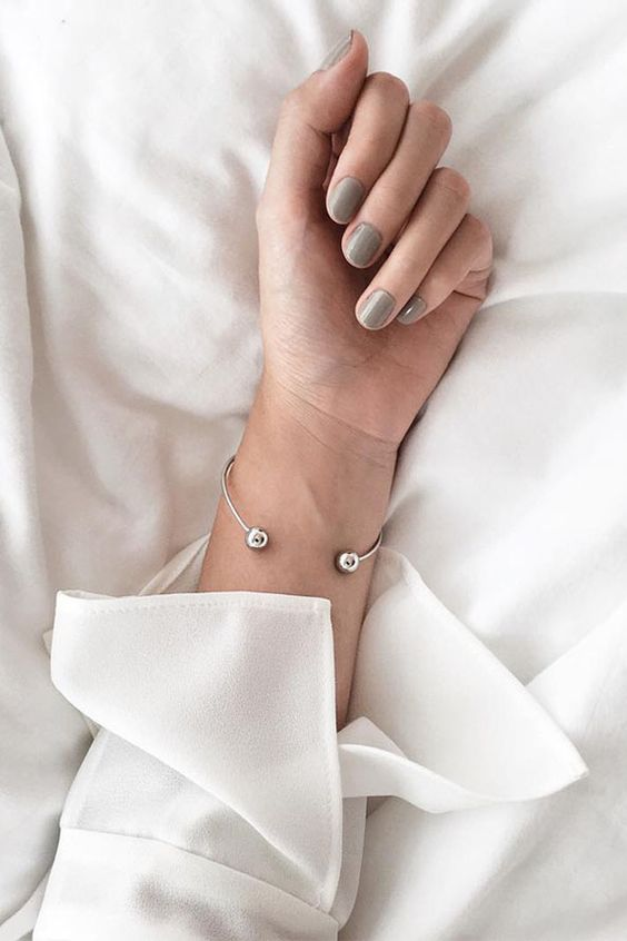 a minimalist open bracelet with two bead is a chic and stylish idea that will never go out of style
