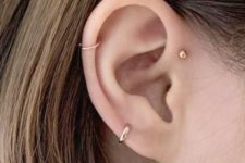 15 a single gold stud and a duo of gold hoops of various width for minimalist styling