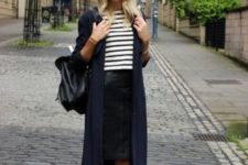 15 a striped top, a black leather skirt, black trainers, a navy cardigan and a black backpack