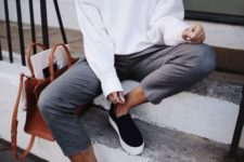15 a white sweatshirt, grey cropped pants, black slipons, layered necklaces and a brown bag