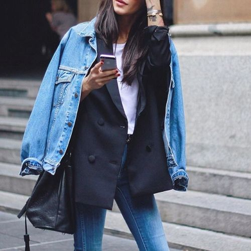 blue jeans, a white tee, a black blazer and a blue denim jacket over it to make the business look less formal