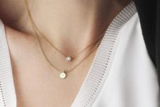 15 layered gold necklaces with a diamond and a little monogram is a very personalized idea