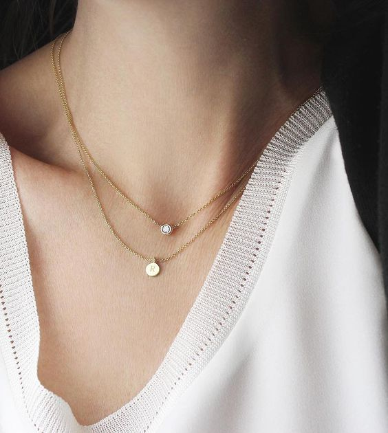 layered gold necklaces with a diamond and a little monogram is a very personalized idea