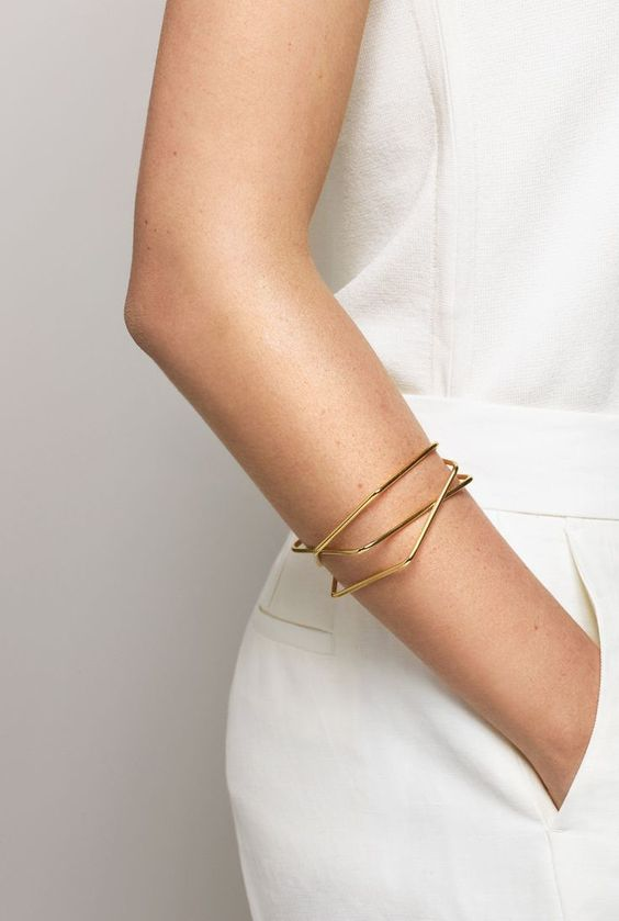 a stack of gold geometric bracelets is a chic and stylish idea to complete your minimalist outfit