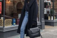 16 blue cropped jeans, a black turtleneck, white sneakers, a black bag and a navy coat