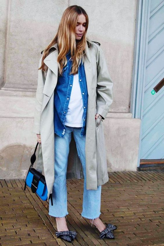blue jeans, a white tee, a blue denim jacket, an olive green trench, bow heels and a small bag