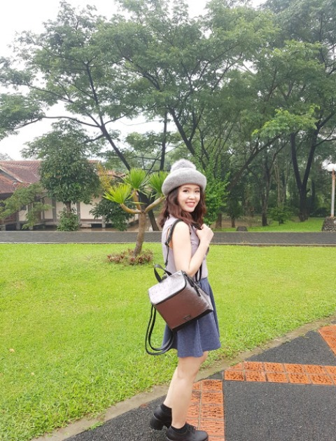 With backpack, gray skater skirt and top