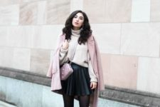 With beige loose turtleneck, pale pink coat, pale pink bag and two colored boots