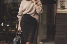 With beige oversized sweater, black bag and white pumps