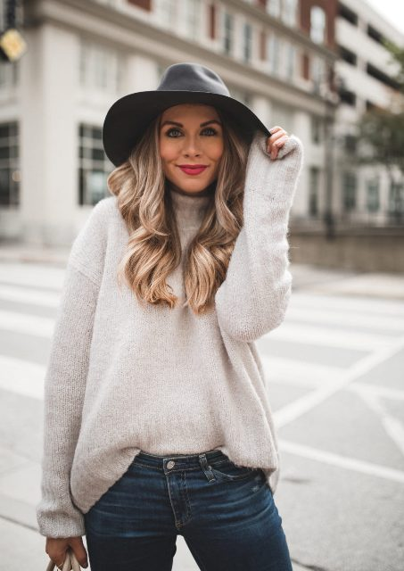 With beige sweater and jeans