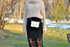 With beige sweater, silver bag and black and brown shoes