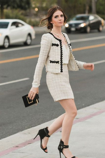With beige top, clutch and ankle strap high heels