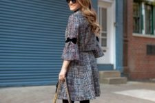 With black chain strap bag, black tights, black pumps and sunglasses