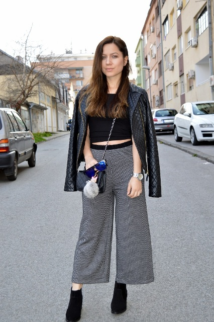 With black crop top, black leather jacket, chain strap bag and black boots
