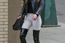 With black hat, black leather jacket, gray skinny pants and black bag