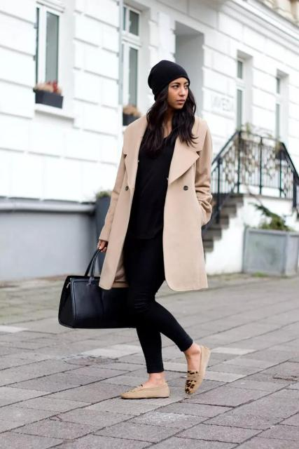 With black hat, black leggings, black shirt, leather bag and beige coat