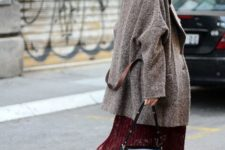 With black hat, gray loose coat, black and blue bag and flat boots