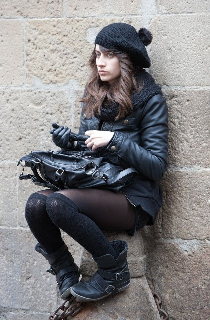 With black jacket, black tote bag, gloves and flat boots