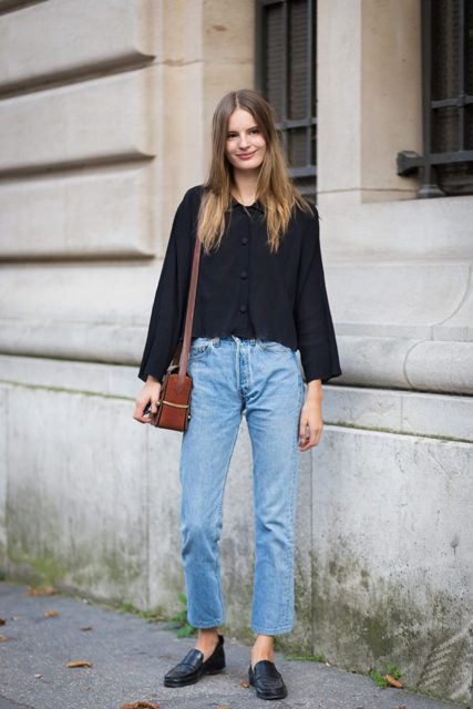 With black loose blouse, brown leather bag and loose jeans