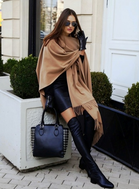 With black mini skirt, black embellished tote bag and beige fringe oversized scarf