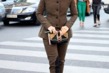 With black pumps, black hat and two colored small bag