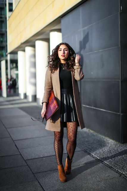 With black shirt, beige coat, brown boots, printed tights and colorful clutch