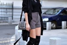 With black shirt, black trench coat, small bag and checked shorts