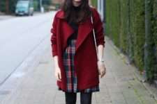 With black shirt, marsala coat, white bag and black patent leather ankle boots