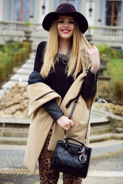 With black shirt, necklace, black leather small bag, leopard leggings and beige coat