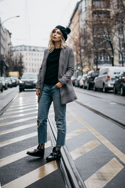 With black shirt, tweed blazer, distressed jeans and black embellished boots