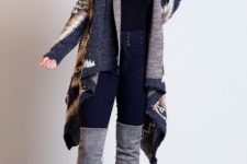 With black top, skinny high-waisted jeans and gray suede over the knee boots