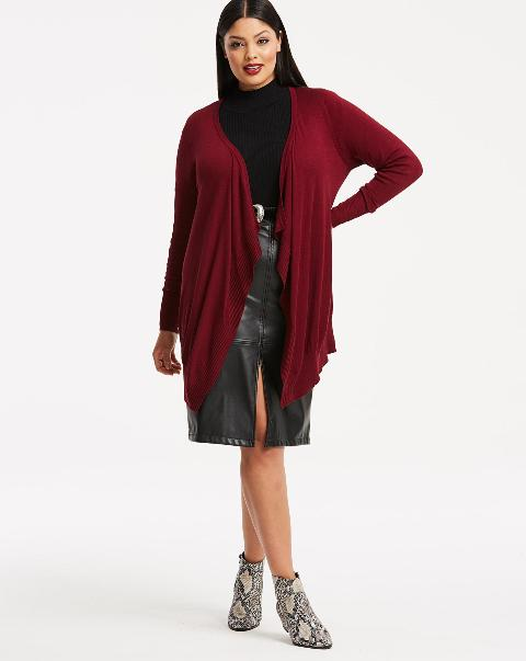 With black turtleneck, black leather knee-length skirt and printed ankle boots