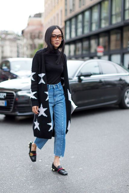 With black turtleneck, cropped jeans and printed cardigan