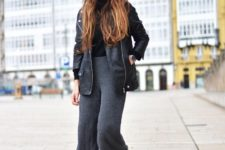 With black turtleneck, leather jacket and white ankle boots