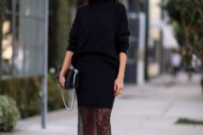 With black turtleneck sweater, black bag and black high heels