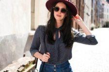 With blouse, denim mini skirt, black bag and sunglasses
