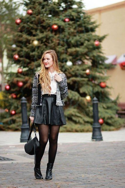 With blouse, printed jacket, black leather bag and black boots