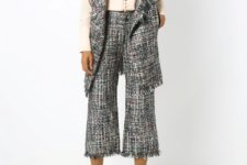 With blouse, tweed long vest and beige pumps