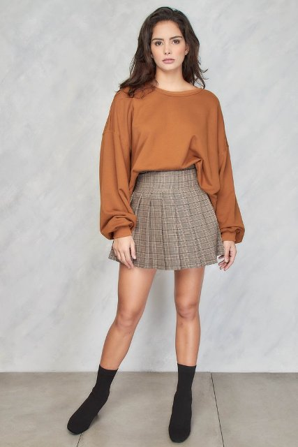With brown loose blouse and black sock boots