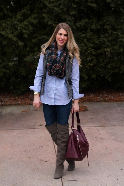With button down shirt, plaid scarf, purple bag, jeans and gray high boots