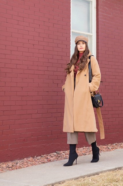 With cap, beige midi coat, black bag and black high heeled boots