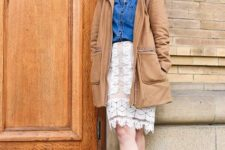 With denim shirt, beige coat and black leather ankle boots