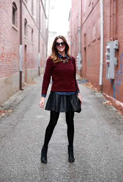 With denim shirt, marsala sweater, necklace, black tights and black heeled boots