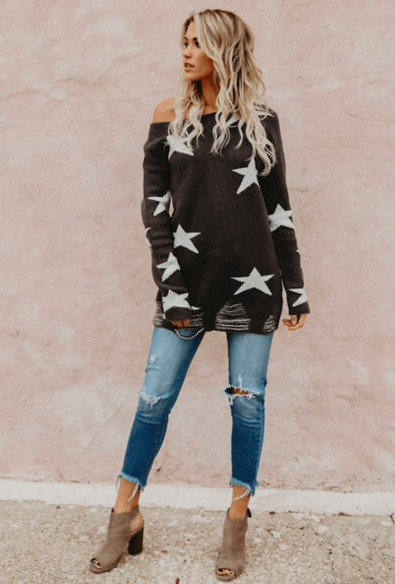 With distressed cropped jeans and gray suede cutout boots