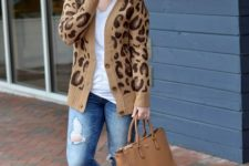 With distressed jeans, lace up flats, tote bag and loose shirt