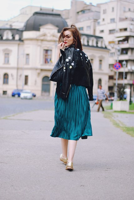 With emerald midi skirt and golden shoes